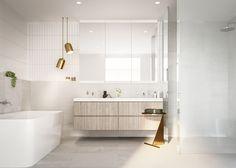 Amamos a combinação dos revestimentos claros com os detalhes em dourado neste banheiro projetado pelo escritório australiano Tecture!