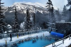 Enjoy a soak in the outdoors natural spring hot tub in Banff's most famous resort - The Fairmont Banff Springs #Banff
