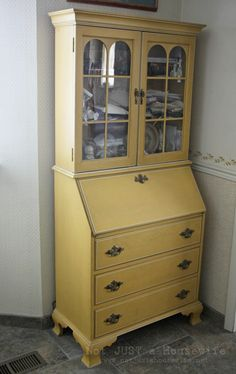 I just bought a secretary's desk... considering painting it yellow. Maybe leaving the pretty wood stain on the inside?