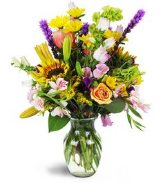 Luscious yellows, greens, pinks, and purples bring the bounty of summer  blooms indoors to deliver your heartfelt message with panache. Whether  it's a birthday, a promotion, or a