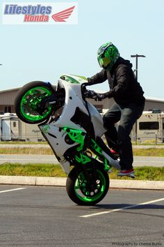 Bruce Tuia on a white and green 2005 Yamaha R6.