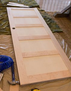Awesome Idea! Turn a flat hollow core door into a vintage look door with flat wood trim! Jenna Sue: Foyer Update: DIY Salvaged Door