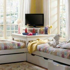 Like the idea of the TV in the center and the drawers underneath
