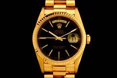 Rolex Day-Date in 18k Gelbgold (ca. 1990)  Präsident Band, Schwarzes Zifferblatt, Strich Indexe, geriffelte Gelbgold Lünette  Referenz: 18238   E-Serie   Ø 36 mm  http://www.juwelier-leopold.de/uhren/rolex/day_date.html
