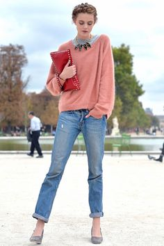 Model Frida Gustavvson wears a casual mohair knit, boyfriend jeans, and a classic Valentino studded clutch.