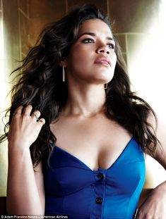 Sultry beauty: America Ferrera showed off her decolletage in a low-cut blue dress as she  ...