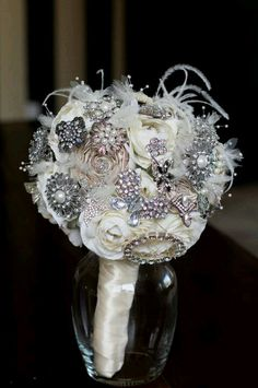 brooch bouquet. Love filling in with floral and feathers