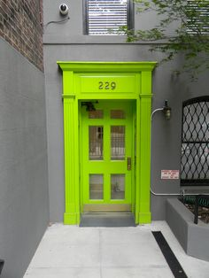 Lime Green door in NYC ... If I lived there I would totally paint my door lime green. :)