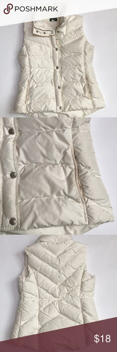 """J.Crew Puffy Vest J.Crew puffy off white vest size size medium. Great preloved condition- some discoloration around pockets shown in picture. Snap and zipper closure. Pockets have Snap closure. Drawstring closure inside. 19.5"""" from underarm to underarm and 22"""" long.   100% polyester. Filling is  minimum of 80% down and remainder is waterfowl feathers. J. Crew Jackets & Coats Vests"""
