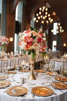 These coral, peach and white centerpieces by Posh Floral Designs are strikingly beautiful! We love these hues in this elegant wedding! Kassie Moore Photography   Jacqueline Events  & Design #bridesofnorthtx #weddings #centerpieces