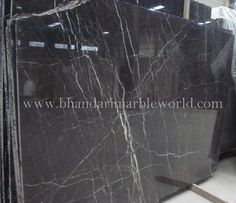 BLACK MARQUINO 2 This is the finest and superior quality of Imported Marble. We deal in Italian marble, Italian marble tiles, Italian floor designs, Italian marble flooring, Italian marble images, India, Italian marble prices, Italian marble statues, Italian marble suppliers, Italian marble stones etc.