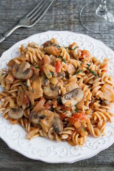 Quick & Easy Creamy Tomato Mushroom Pasta. Vegan and easily made gluten-free by using GF pasta.