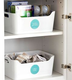 Above the dryer, a plastic tote is dedicated to misfit socks, so all family members know where to search first when items go missing. A clearly labeled coordinating tote gathers batteries, lightbulbs, small home-repair tools, and other utility staples.