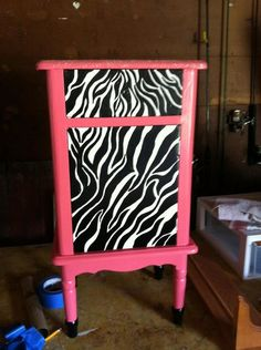 I Took this old little table with great scalloping and painted it watermelon smoothie for my niece's bedroom. I hand painted the zebra stripes because I couldn't find a stencil I liked and did a glitter application on the top. Every 5 year old's dream! This she can also grow into. Handles are custom made and yet to be put on.