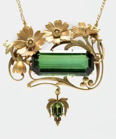 An Art Nouveau tourmaline floral pendant-brooch.