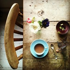 Farmhouse table. Coffee. Flowers.
