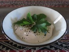 """Haydari is a Turkish yoghurt meze. Herbed and spiced yoghurt, so to speak. There is another variety of it which uses both yoghurt and feta cheese. The recipe below uses yoghurt only. But, I know how to make cheesy one, … <a href=""""http://vegfusion.org/recipes/haydari-turkish-yoghurt-dip/"""">Continue reading <span class=""""meta-nav"""">→</span></a>"""