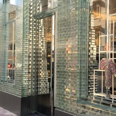 Detail front shop Chanel Amsterdam | bricks glass