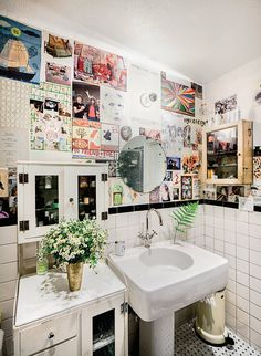 bathroom filled with plants and images of interest (From NY Times Real Estate Chain of Love and Admiration)