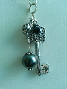 Silver gun metal with dangling pendants by AccentsbySamantha, $18.00