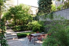A private backyard oasis in the city at our Warren Street Townhouse in Brooklyn NYC. Wood decking, concrete pavers, and lush vegetation.