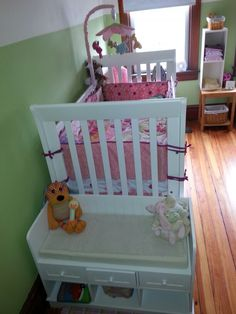Small sitting bench for storage of toys / buddies at end of crib.