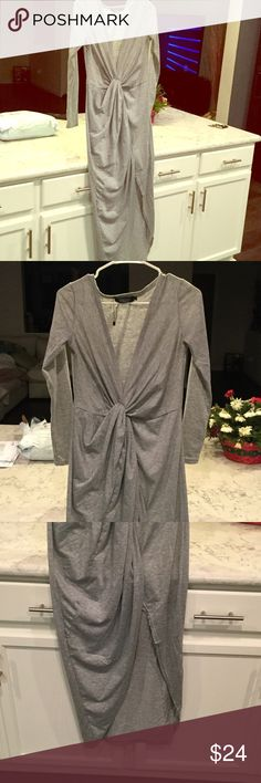 "BNWOT. HEATHER GRAY MAXI Beautiful maxi dress with front knotted accent. Long sleeves. Low plunging neckline. Measures 51"" long 15"" arm to arm. Sleeves are 22"". Veronica Dresses Maxi"