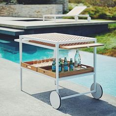 Complete sophisticated summer spaces with Hatch Bar Cart designed by - a perfect addition to any poolside lounge. Pictured here: Hatch Serving Cart Outdoor Bar Cart, Outdoor Dining, Indoor Outdoor, Outdoor Spaces, Serving Cart, Luxury Restaurant, Global Design, Cool Bars, Outdoor Entertaining