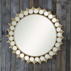 Wow this is one gorgeous mirror! The fleur-de-lis detail gives it a classic French element. Your eye is pulled to the center due to the smaller circular mirror surrounding the similar large mirror. #FunkyFindsFriday