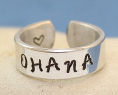 Hey, I found this really awesome Etsy listing at https://www.etsy.com/listing/167259403/ohana-ring-personalized-ring-adjustable