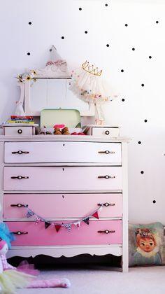 Cute pink ombre dresser.