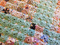 This antique quilt is incredible! Yo Yo antique quilt 1930s eau de nil bedpread. $225.00, via Etsy.