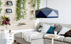A comfortable sofa with a chaise section fits perfectly into a corner of the small living space