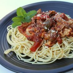 "Chicken Cacciatore in a Slow Cooker I "" Served over spaghetti with a sprinkle of Parmesan, it was a hearty and easy meal, and one that I would prepare again."""
