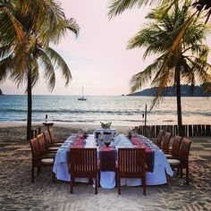 Seaside sunset dinner flanked by palm trees at Viceroy Zihuatenejo. @ericrosenla