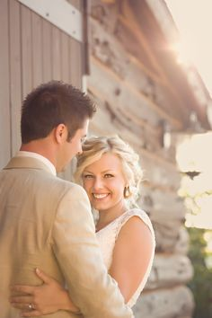 I've become a big fan of bride and groom photos in which only the bride is looking at the camera. This particular photographer shows several examples of this on her blog.