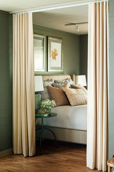 Create a cozy bedroom nook by hanging curtains. If you're not comfortable mixing patterns, try using varying textures instead, as the designer did here.