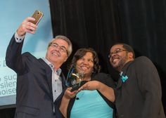 Dave North demonstrates selfie skills with Tiffany and Anthony Lowery
