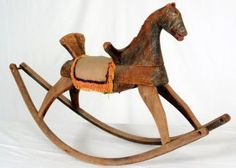"""Child's Folk Art Rocking Horse, Circa 1830's-40's, with Original Paint colors 26""""h x 13""""w x 45""""d sold for $175"""