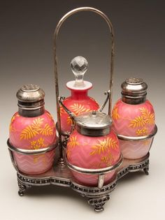 HERRINGBONE AIR-TRAP MOTHER-OF-PEARL FOUR-BOTTLE CONDIMENT SET,