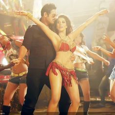 John Abraham and Sophie Choudry in a still from the Bollywood movie Shootout At Wadala  ... Watch Bollywood Entertainment on your mobile FREE : http://www.amazon.com/gp/mas/dl/android?asin=B00FO0JHRI