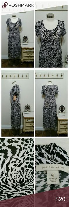 "Animal Print Dress by Jonathan Martin, stretch Comfortable casual animal print dress by Jonathan Martin, size medium, stretchy.   Drop waist, short sleeves.  Measurements:  38/38"" bust 32"" waist 38/40"" hips 47"" length  Very good gently used condition Jonathan martin Dresses"