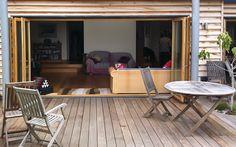more oak bifold doors in sussex Oak Bifold Doors, Windows And Doors, Conference Room, Table, Furniture, Home Decor, Decoration Home, Room Decor, Meeting Rooms