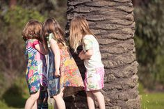 Luau T Shirt Dress and Fiesta Dress play hide and seek behind an enormous palm tree, helped by Ballet S/S Pocket Tee and Leilani Skirt (Note: Sleeves on Ballet Tee differ in production - see website)