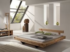 old wood frame, low bed