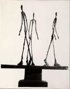 three figures walking in different directions on signed pedestal base  A. Gacometti .