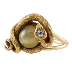 Cats Eye Chrysoberyl and Diamond Snake Ring | From a unique collection of vintage more rings at http://www.1stdibs.com/jewelry/rings/more-rings/
