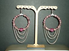 Hoop earrings with 2 different sizes glass beads and chains hanging