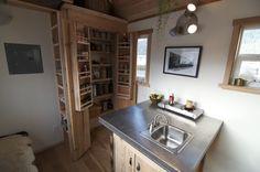 Kitchen storage idea (in 120 Sq. Ft. Acorn Tiny House by Nelson Tiny Houses ) http://tinyhousepins.com/120-sq-ft-acorn-tiny-house-by-nelson-tiny-houses-for-sale-38k/