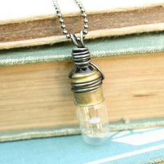 Lightbulb necklace - reclaimed upcycled repurposed light bulb wrapped with dark annealed steel wire